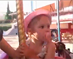 Vera's riding on a merry-go-round